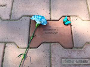 Memorial brick with blue flower and blue butterfly magnet