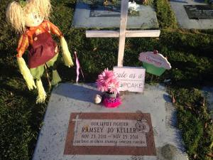 Headstone decorated with toys